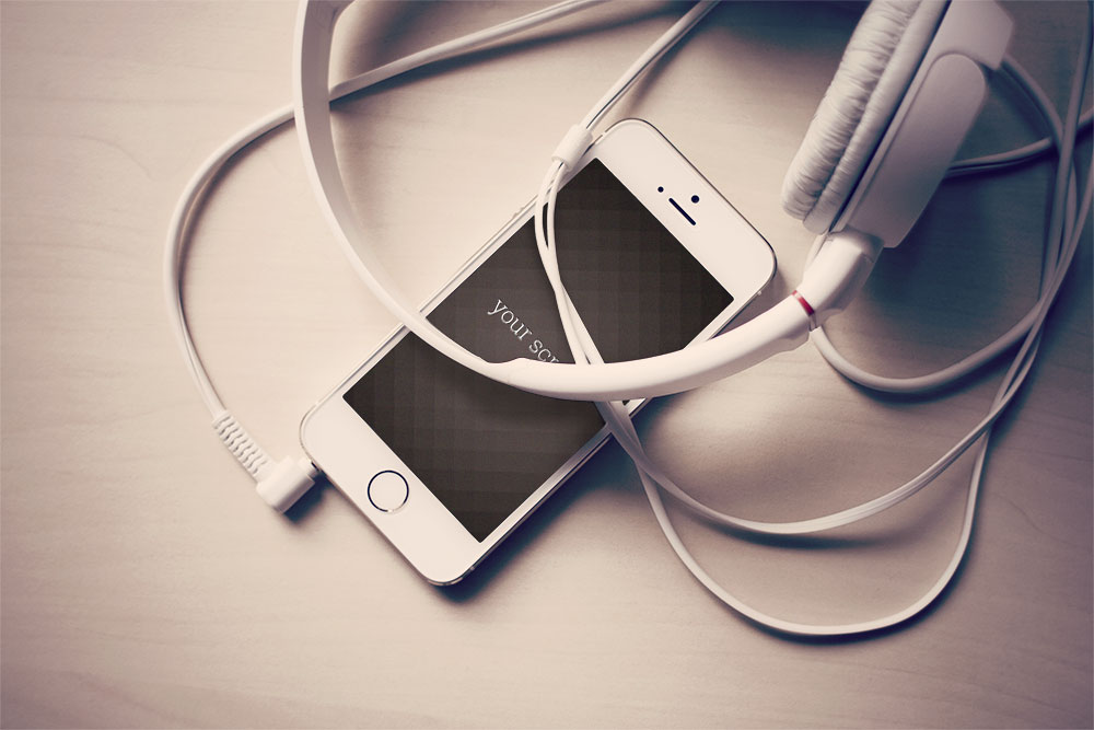 free iPhone mock-ups with headphones and laptop